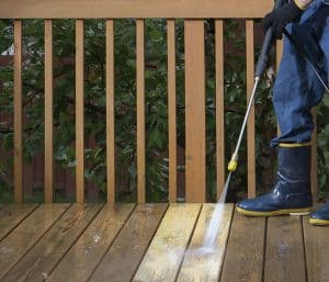 pressure washing a wooden surface